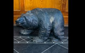 Large Black Forest Style Carved Wooden Bear, Realistically modelled in foraging pose,
