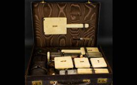Art Deco Twelve Piece Travelling Vanity Set Each with gilt silver collars, hallmarked London 1941