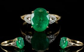 18ct Gold - Faceted Oval Shaped Emerald and Diamond Set Dress Ring,