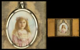 A Late Victorian/Edwardian Portrait Miniature Depicting a young girl painted on ivory,