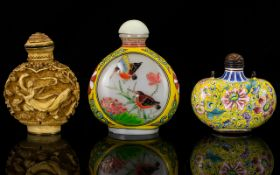 A Collection Of Three Oriental Snuff Bottles To include cloisonne floral decorated bottle,