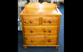 A Pine Chest Of Drawers raised on bobbin feet,