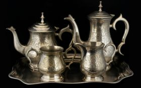A Five Piece Silver Plated Tea And Coffee Service To include tray, teapot, coffeepot, milk jug and