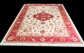 A Very Large Woven Silk Carpet Keshan rug with beige ground and traditional Middle Eastern floral