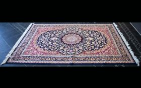 A Large Woven Silk Carpet Keshan rug with cobalt blue ground and traditional Middle Eastern floral