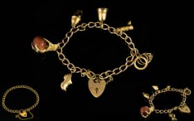 9ct Gold Bracelet Loaded with 6 x 9ct Gold Charms.