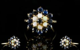 A 9ct Gold Cluster Ring Set with central