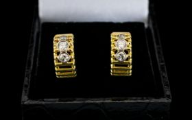 A Pair Of 18ct Gold And Diamond Set Earr