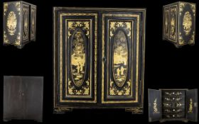 Early 20th Century Oriental Lacquered Chest Comprising two panelled doors,