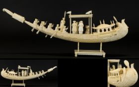 A Superb Quality Indian Ivory Carved Model of a Ceremonial Boat with figures.