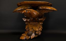 A 1920's Golden Oak Clock Bracket Modelled In The Form Of An Eagle With Outstretched Wings,