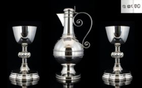 A Magnificent Late 19th Century Solid Silver Claret Jug and Matching Pair of Silver Chalices with