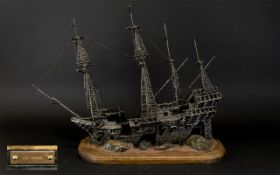 Metal Shipwreck Model On A Wooden Base, Height 43cm, Length 40cm.