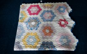 Early 20th Century American Patchwork Quilt Polychrome pieced quilt in hexagonal floral design with