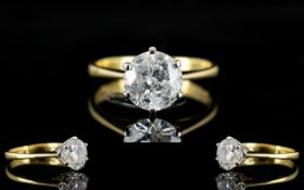 An 18ct Gold Single Stone Diamond Ring Set with a round modern brilliant cut diamond in six claw
