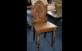 Oak Hall Chair - early 20th century carved back chair of small proportions and curlicue back.
