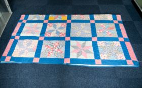 A Late 19th Century American Northumberland Patchwork Quilt Hand stitched in polychrome cotton with