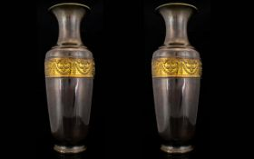 A Pair Of Mixed Metal Vases Of neoclassical design with swag and scroll borders. Each drilled and