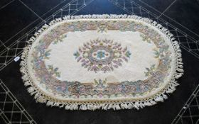 Oval Wool Rug Cream ground with grey, blue, green, pink and taupe floral and foliate border