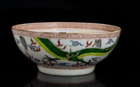 Chinese Famille Vert Painted Bowl Decorated with two four clawed dragons amongst clouds,