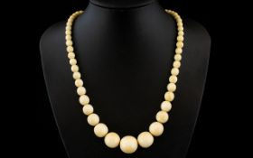 Antique Period Nice Quality Carved Ivory Beaded Necklace in Graduated Form. Age related patina.
