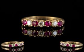 Ladies 9ct Gold - Six Stone Ruby & Diamond Dress Ring. The rubies and diamonds of pleasing colour.