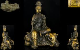 A Bronze Figure Of Pu Huin Riding Six Tusked Elephant. Impressed seal mark to base and rear, height,