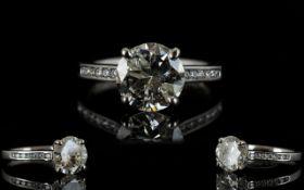 Ladies Platinum Set Attractive Single Stone Diamond Ring Set with Diamond Shoulders.