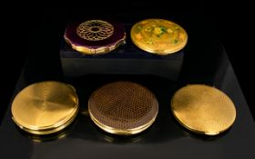 A Collection Of Vintage Kigu Powder Compacts Five in total to include circular gold tone floral
