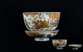 Antique Oriental Tea Bowl And Saucer decorated in under glazed blue depicting flying cranes,