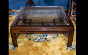 A Modern Oriental Style Coffee Table - low square table with insert glass top and decorative grid