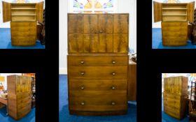 Heal's London Linen Press Concave Shelf Unit above four (4) graduating long drawers and plinth base.