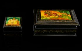 Collection of Russian Lacquer Table Boxes. Comprises: 1. Hand painted oblong Russian Lacquer Box