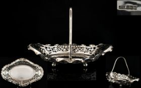 A Nice Quality Solid Silver Swing Handle Fruit Basket with Open worked Sides, Raised on Ball Feet.