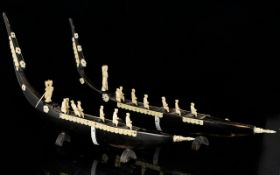 Pair of Hand Carved Model Venetian Gondolas - in horn with decals, gondolier,