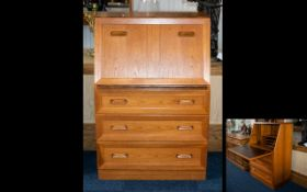 G Plan Writing Bureau - of typical form, fall front above x 3 drawers.