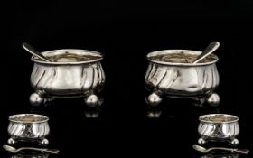 A Pair Of Continental Silver Salts Cauldron Shape With Cannon Ball Feet. With Matching Spoons.
