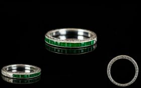 18ct White Gold Emerald Set Half Eternity Ring. The natural Colombian emeralds of good colour.