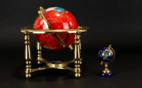 Gem Set Style Globe, With Brass Mount, Red Ground With Gilt Contours, height, 10 inches.