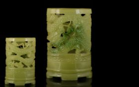 A Jade Coloured Reticulated Vase With Dragon Decoration, footed ovoid vase, height approx 6 inches.