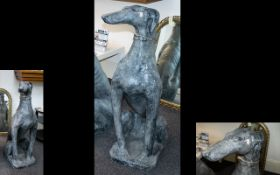 A Large Resin Figure In The Form Of A Greyhound floor standing figure of seated greyhound finished