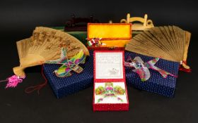 A Collection of Oriental Toys to include
