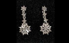 Diamond Pair of Drop Earrings, a starbur