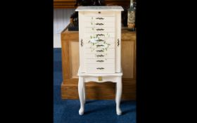 A Modern Jewellery Cabinet - free standing cabinet on queen anne legs comprising ten drawers;