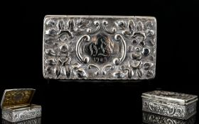 Victorian Period Silver Lidded Snuff Box with Embossed Decoration to Cover and Sides of Pleasing
