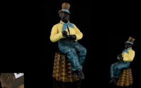 French Original Delarue Picard Paris Handpainted Black Male Figure seated on a stool/basket.