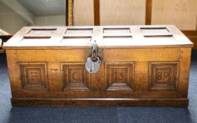 Antique Coffer - of panelled form with antique effect padlock, carved panels to front,