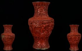 Antique Chinese Cinnabar Vase Lacquered floral design with figures, some damage, height 6¼ inches,