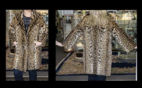 1960's Ocelot Coat Full length coat with side seam pockets, revere collar and hook and eye closure.