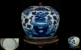 Antique Jar And Cover Blue and white jar of globular form depicting blossom, with wooden lid,